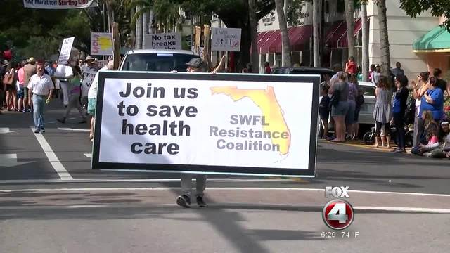 Marchers rally for Obamacare in MLK parade