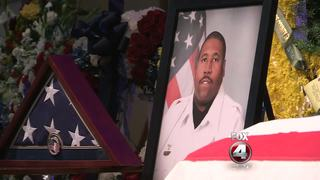 Thousands pay their respect to Dep. Norman Lewis