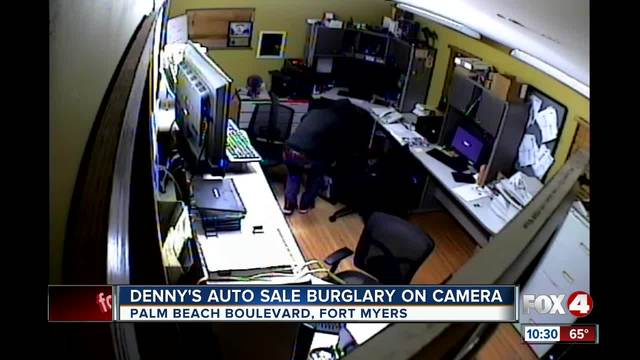Burglar caught on camera stealing a safe from Denny-s Auto Sales