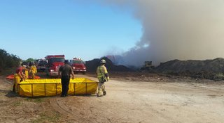 Mulch fire continues to burn in Lee County