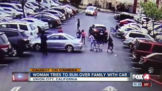 Woman tries to run over a family with her car