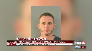 Man shoots at person, barricades himself in home