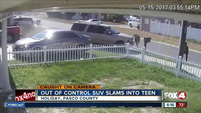 Teen unhurt after SUV plows into him
