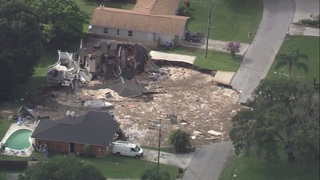 Pics: Land O'Lakes sinkhole swallows two homes
