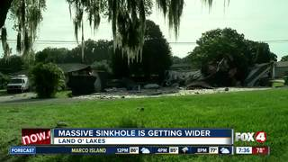 Officials: Massive sinkhole is getting bigger