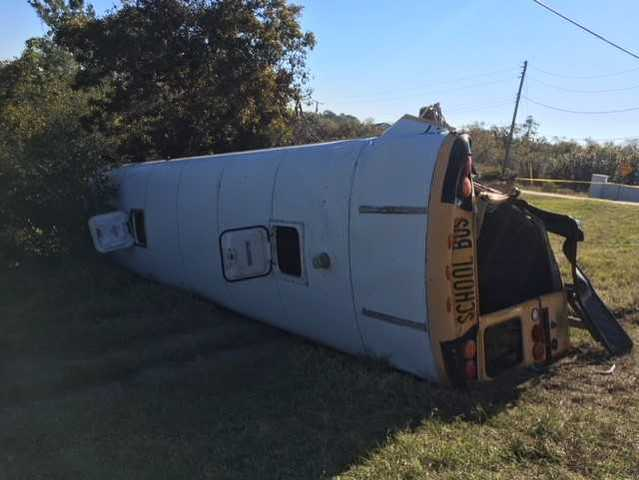 Semi-truck hits school bus full of kids, causing it to flip
