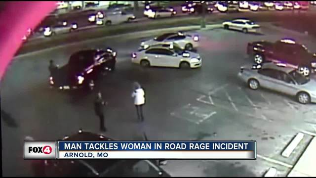 Suspect in road rage attack charged, remains at large