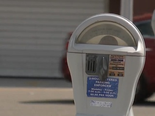 Parking meters getting repaired with old parts