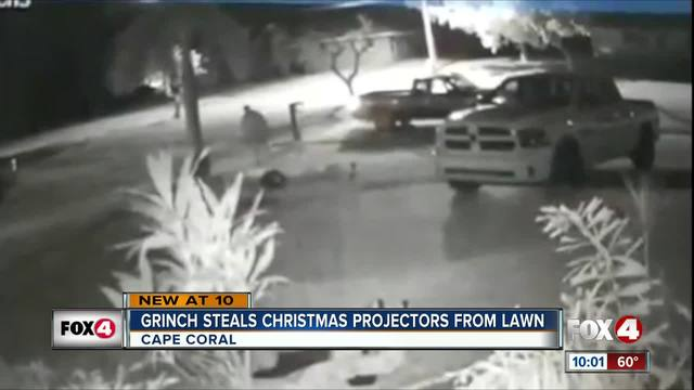 Grinch Steals Christmas Projectors from Lawn