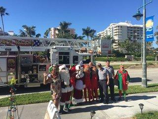 Kiwanis Club of Marco Island sings with Santa