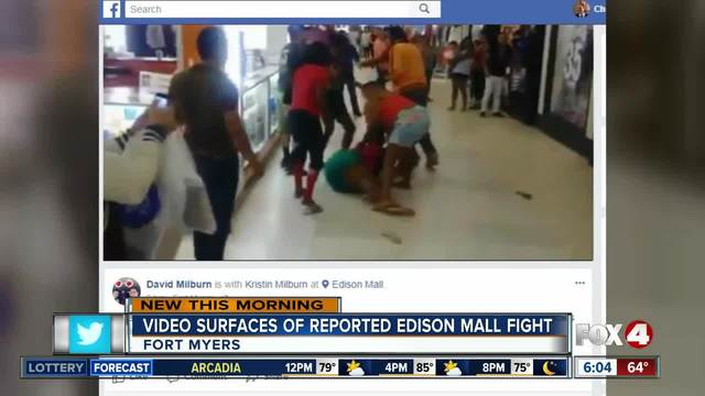 Woman pushing child in stroller joins mall brawl