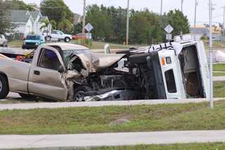 Photos: Postal truck overturns in Cape Coral