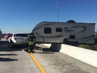 Photos: Camper hangs off I-275 overpass