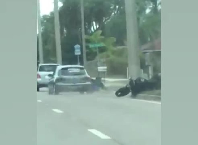 Florida deputies search for road rage suspect seen ramming vehicle into motorcyclist