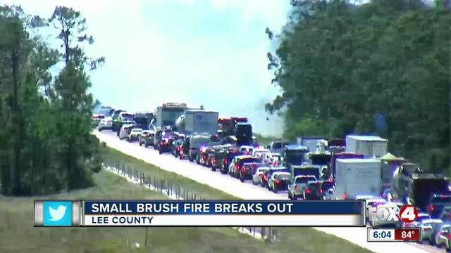 Crews battle brush fire along I-75 in Lee County