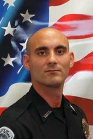 Identity of wounded officer released