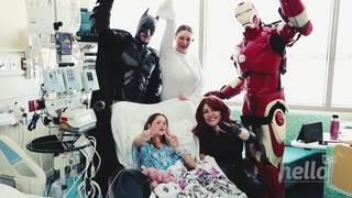 Local superheroes surprise sick kids