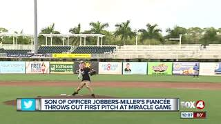 Officer's family throws out Miracle first pitch