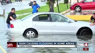 Heavy rain leaves cars flooded