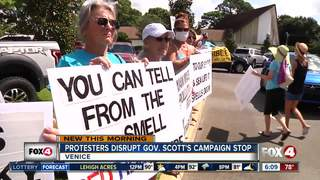Gov. Scott confronted by protesters