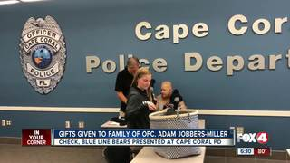 Gifts given to family of fallen officer