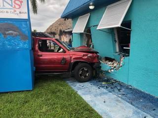 Police name driver in car crash into restaurant